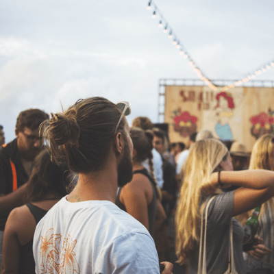 Festivals & Events: Bus Hire and Coach Services: guy watching a gig at a festival