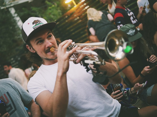 Man playing a trumpet at a jazz festival