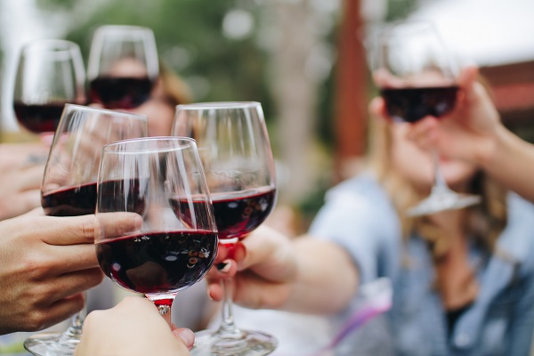 group of friends enjoying a wine together at a festival