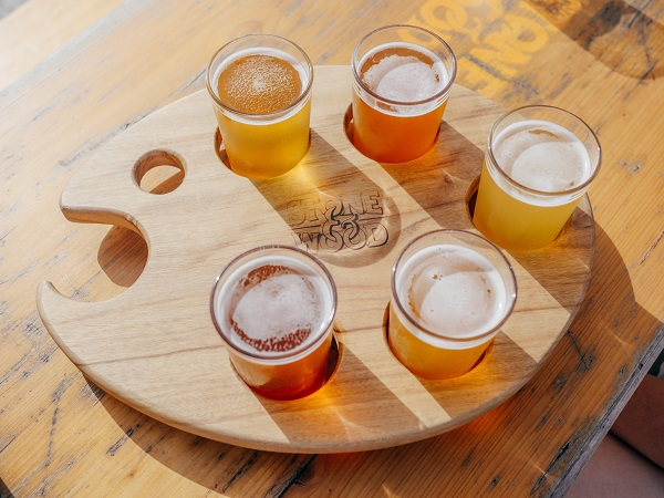 A paddle board of various beers at a brewery