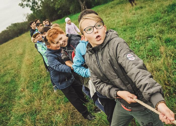 Kids playing tug of war at a school camp near perth