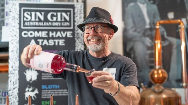 Sin gin owner pouring his famous gin in the swan valley